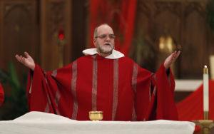 Fr Jim saying Mass